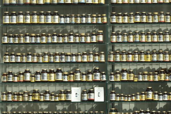 Shelf full of pill bottles