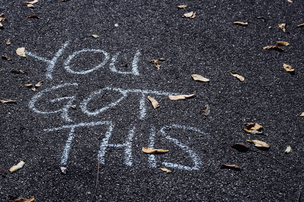 """Chalk on the road that says """"you got this"""""""