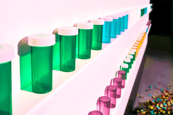 shelf full of empty pill bottles